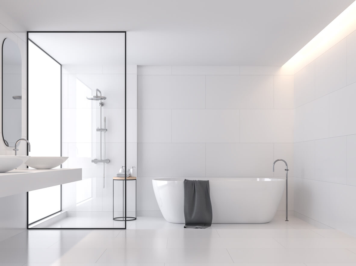 Minimal style white bathroom 3d render, There are large white tile wall and floor.There have glass partition for shower zone,The room has large windows.Natural light transmitted through the room.