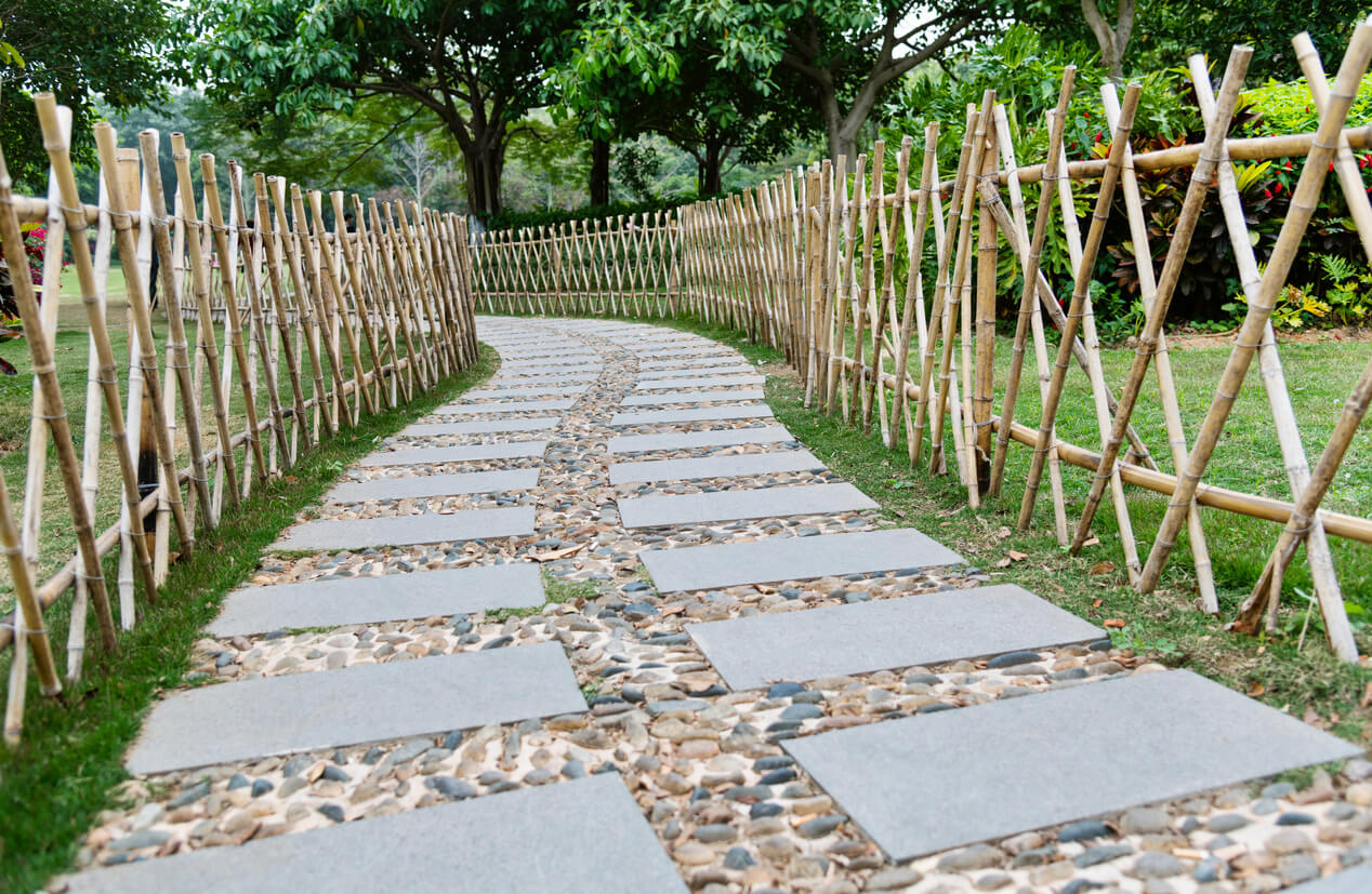 Stone path with bamboo fence in the park.