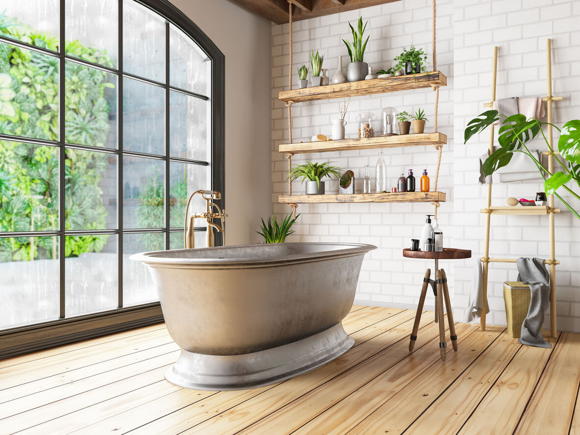 white brick patterned walls with floating shelfs and freestanding bath.