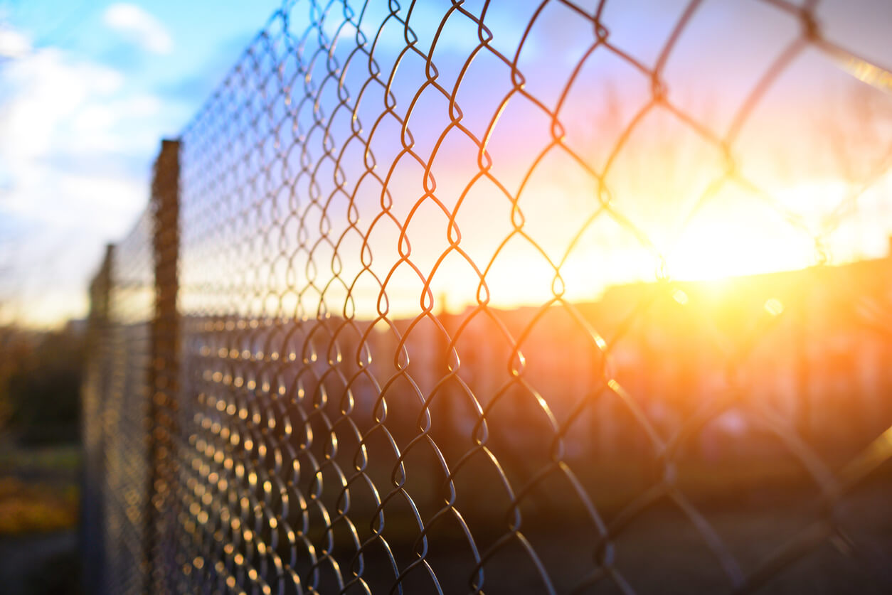 chain link fence with metal grid in perspective, background