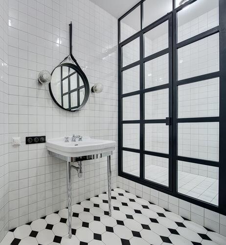 diamond tile flooring in black and white. Black frame shower.