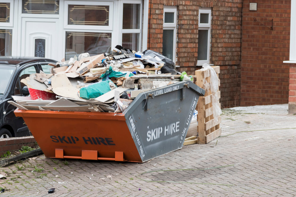 Street side skip filled with rubbish
