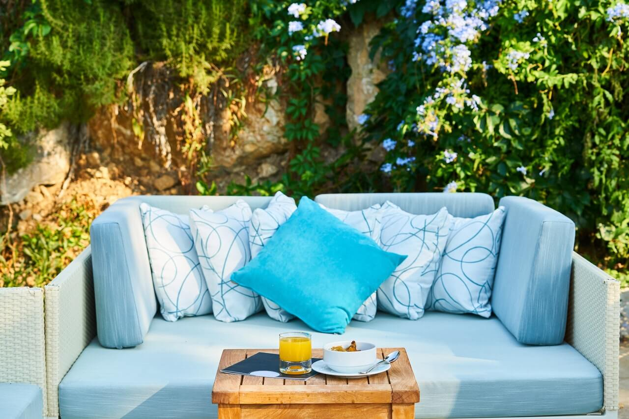 Blue Throw Pillow and Brown Wooden Table Outdoors