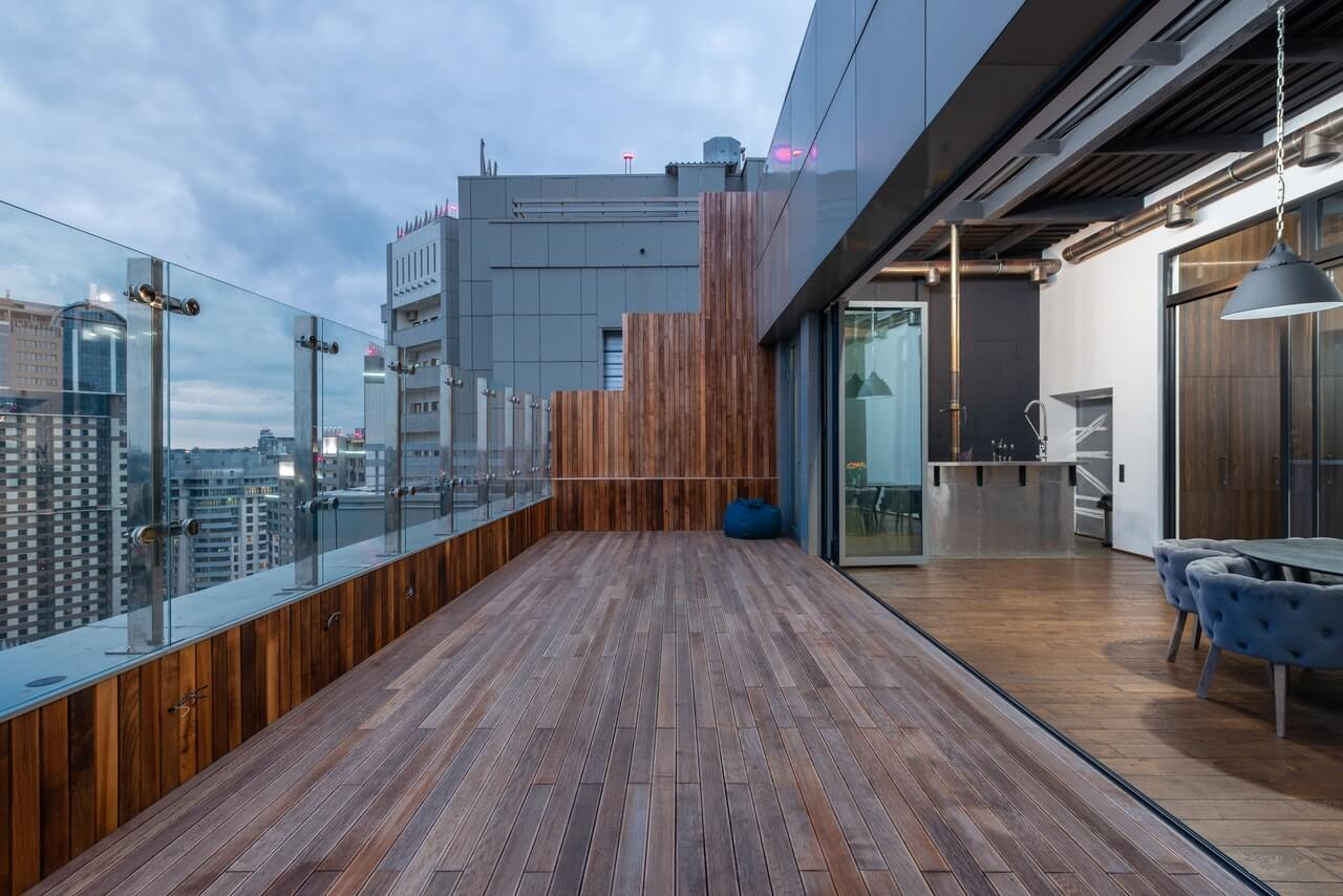 Spacious terrace of modern apartment in evening time