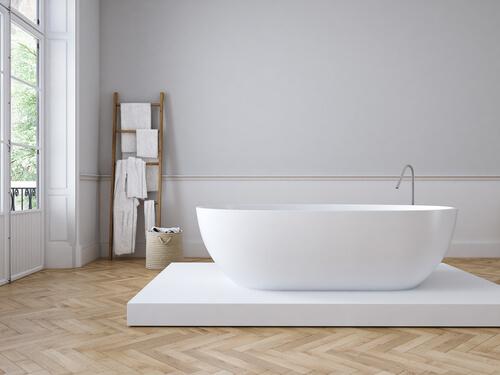 White bath on wooden floor.