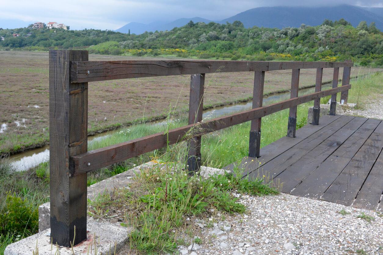 Split rail fence on old bridge over the river
