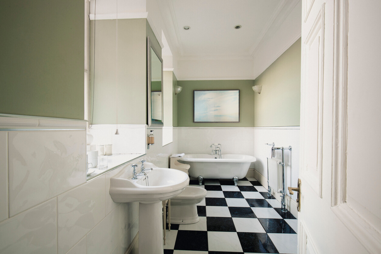A clean, simple bathroom with a checked pattern tiled floor.