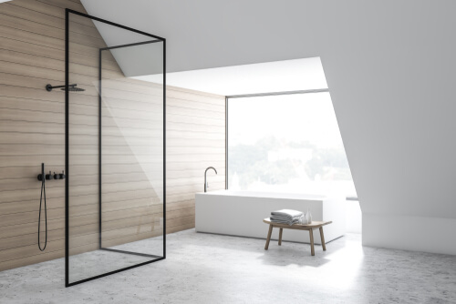 Black frameless shower with wooden wall