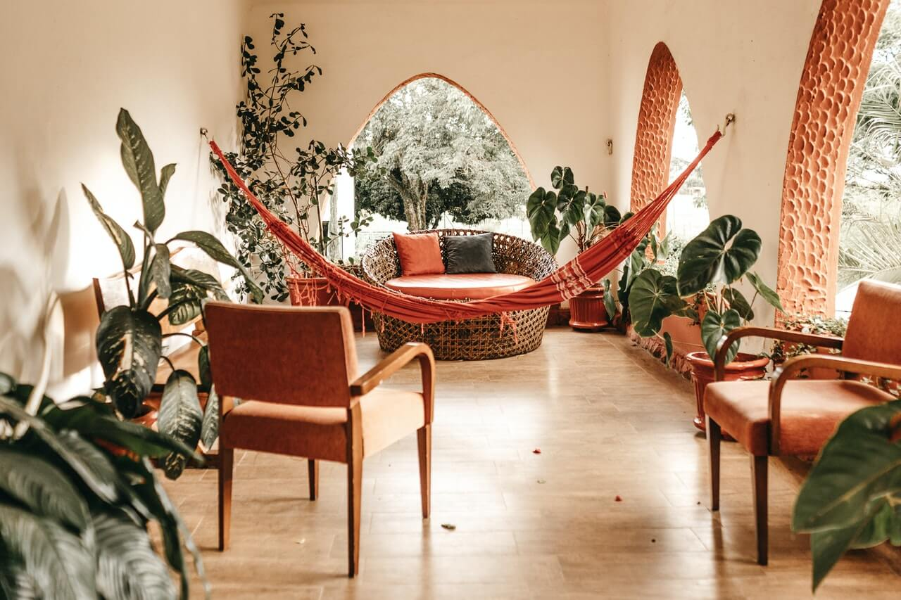 Room with wicker furniture and plants