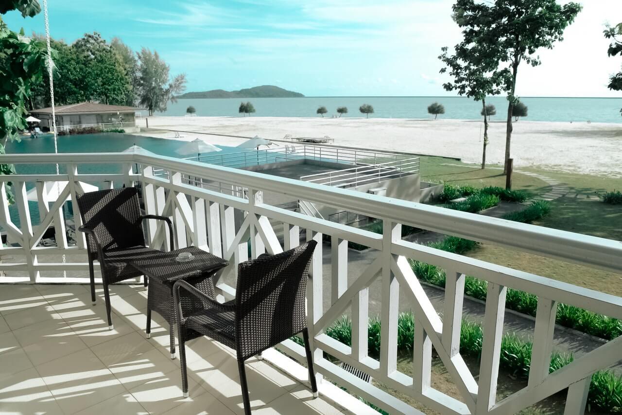 Black Wicker Bistro Set on White Terrace Near Ocean