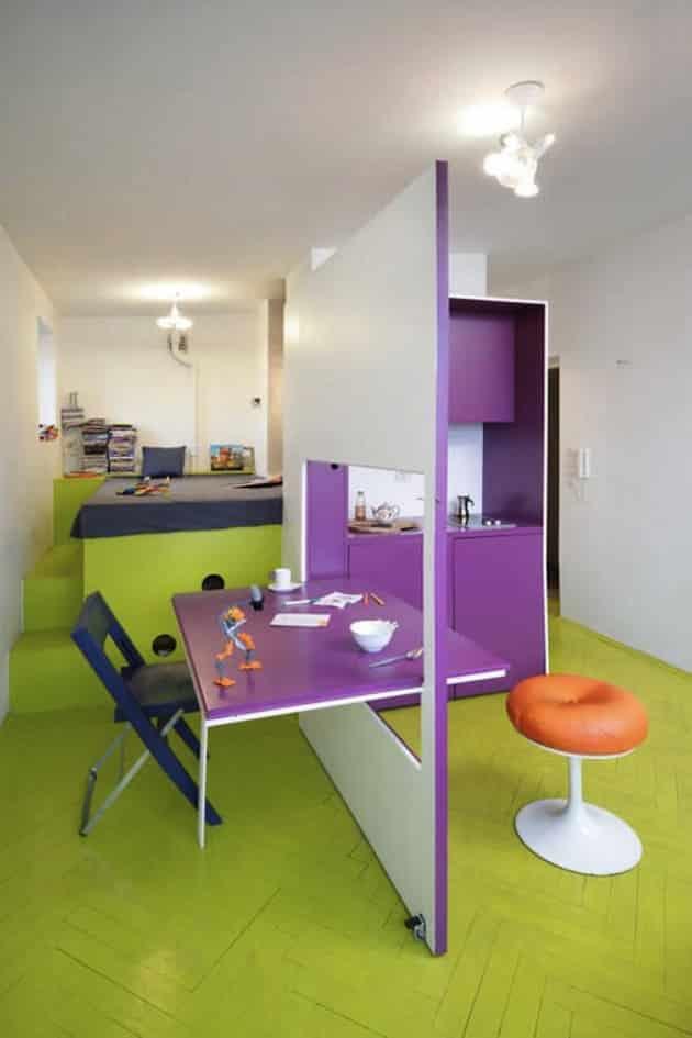Bright green floor in small studio apartment.
