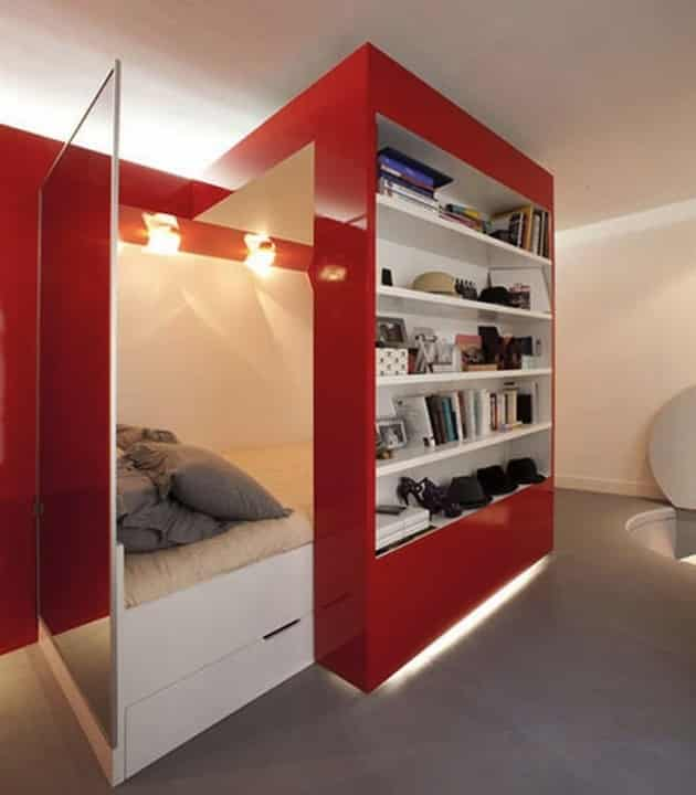 Recess bed in painted red wall