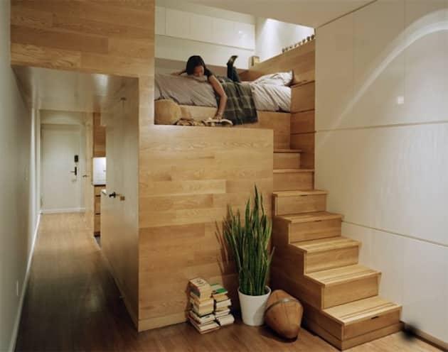 Wooden steps to a platform bed.