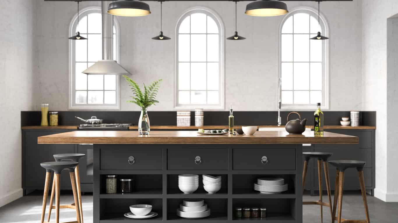 Dark matte grey kitchen island with thick wood top