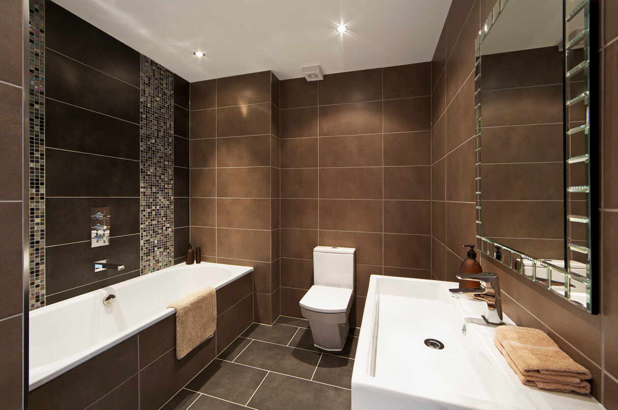 Rectangle brown wall tiles in a modern bathroom