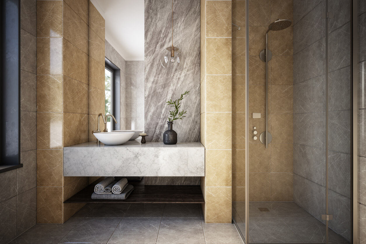 Grey, Beige, Cream tiles in square and rectangle shapes in a walk in shower