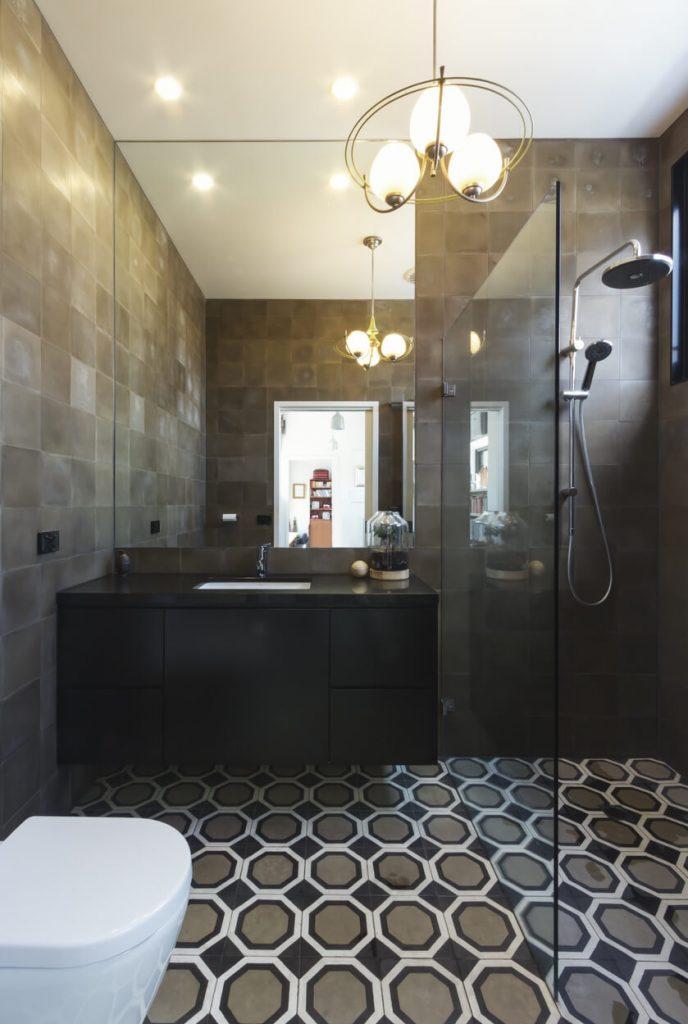 Luxury bathroom in contemporary new home extension in dark masculine tones