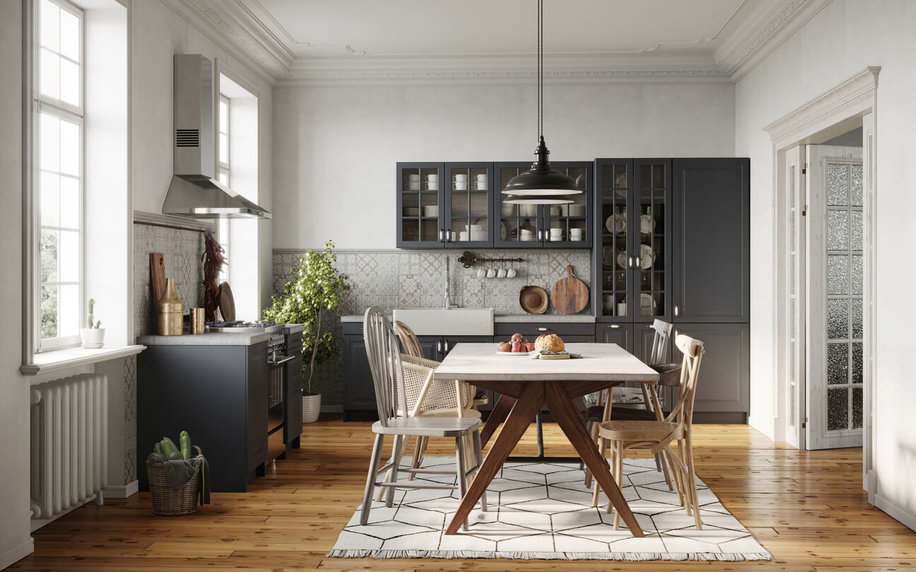 Dining room area design with wooden table and chairs. Small kitchen with dining area and glass cabinets.
