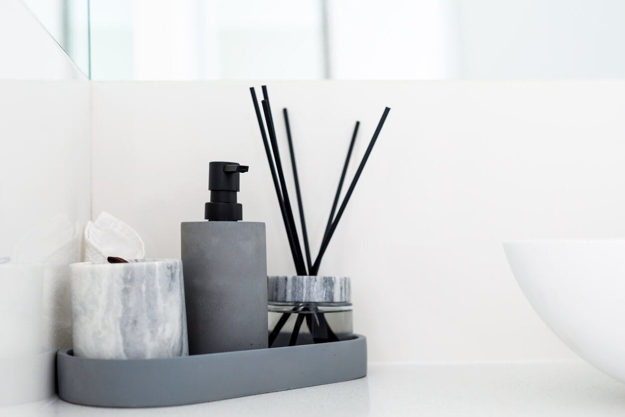 Masculine bathroom accessories in grey and white marble.