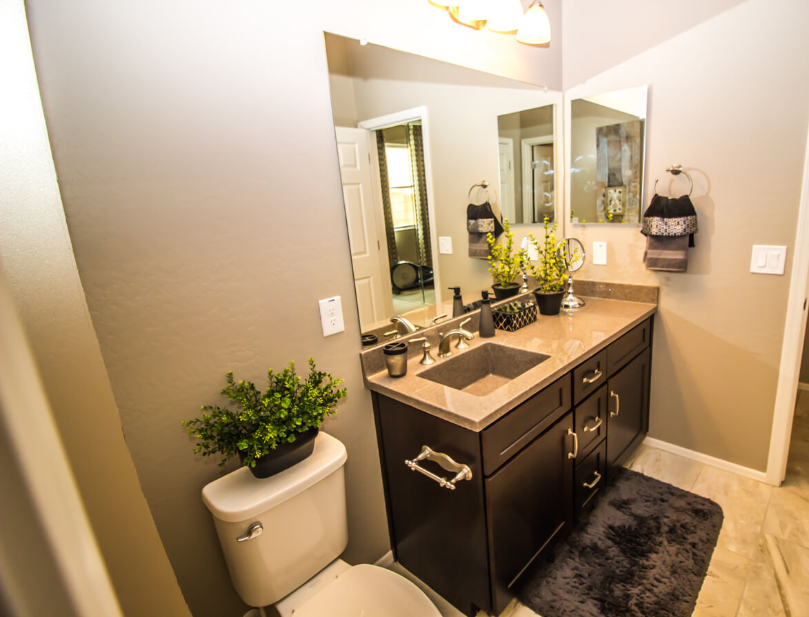 Guest Bathroom With Toilet, Vanity And Square Sink
