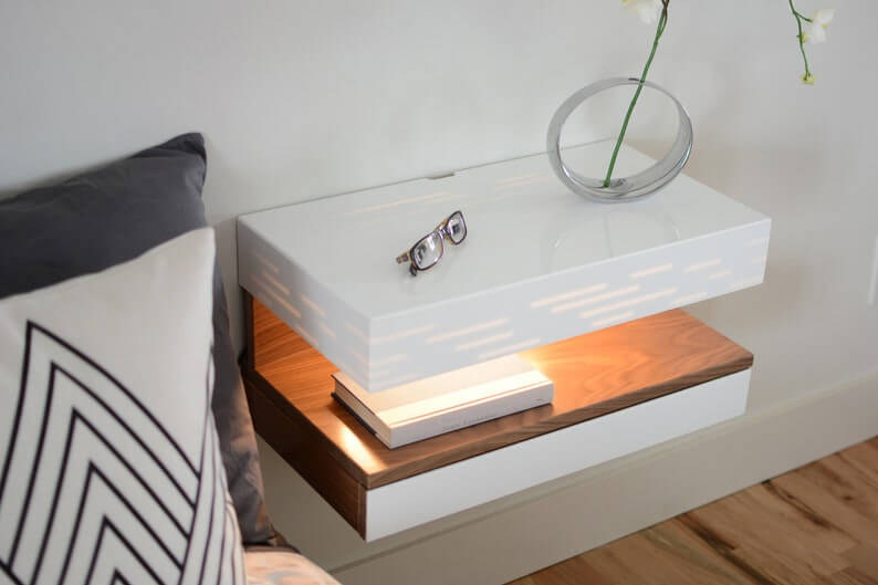 Floating shelf and drawer nightstand in white and wood with inset lights