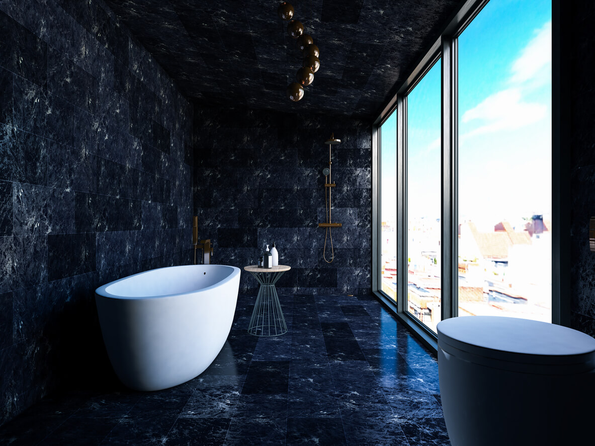 Tiled Black Marble bathroom with brass fittings