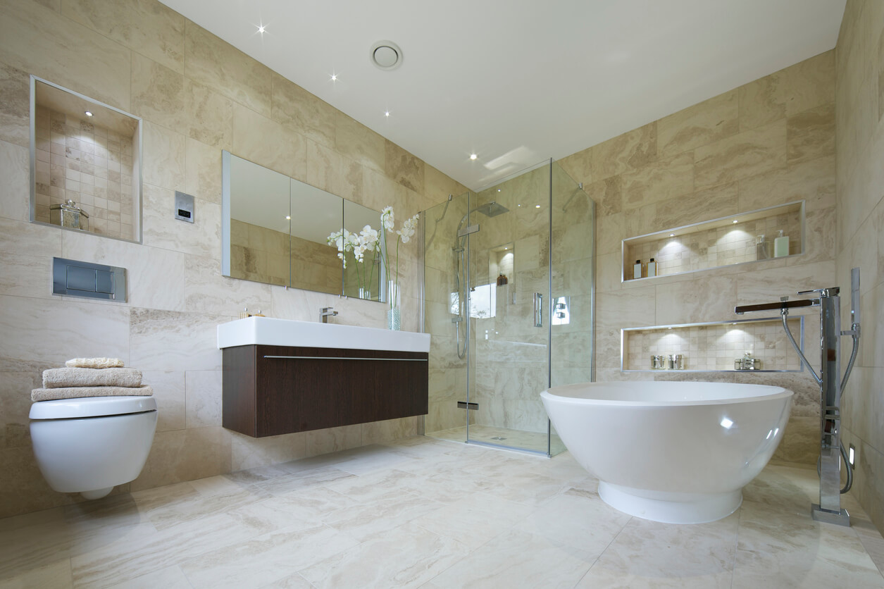 A beautiful bathroom in a luxury home lined with natural stone from floor to ceiling.