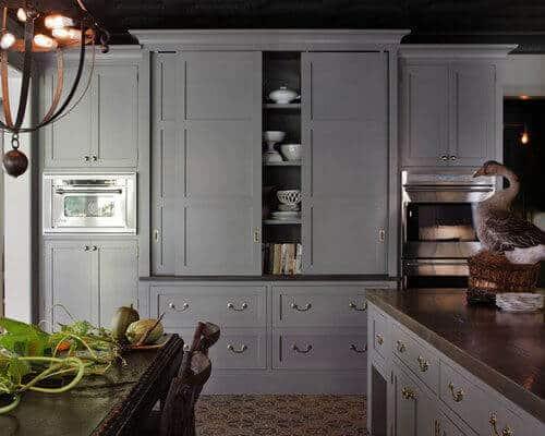 Grey sliding door cabinet in kitchen