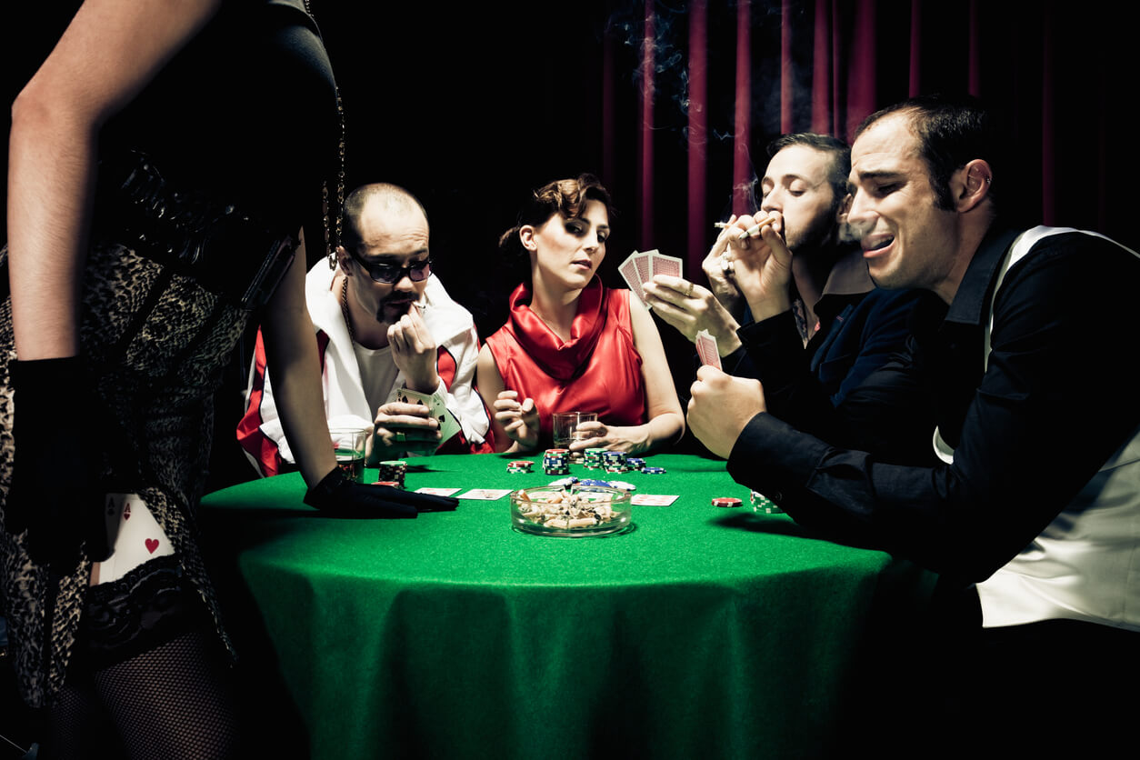 Poker players around a round table with green tablecloth