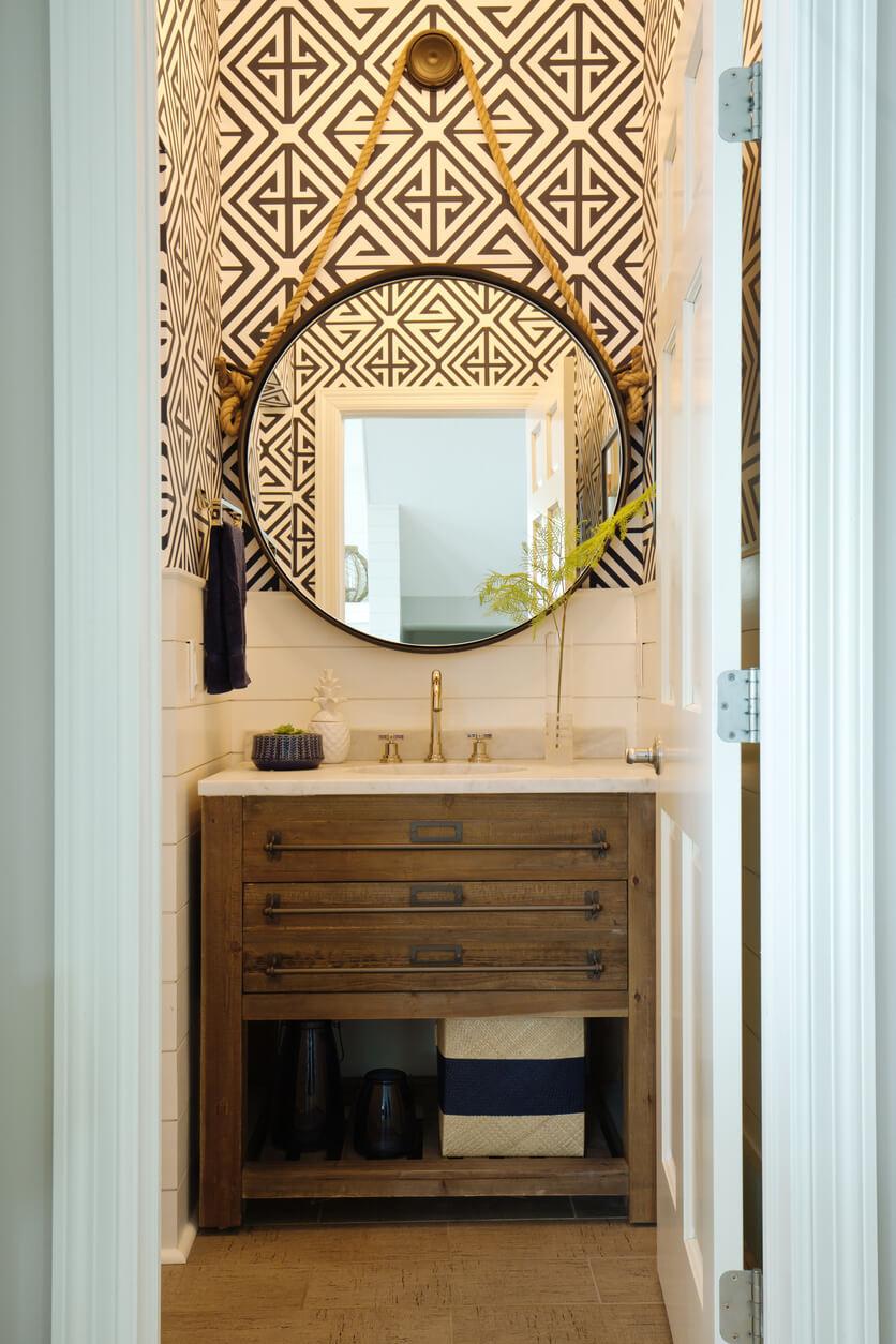 A contemporary modern bathroom design. featuring a contemporary classic vanity and bathroom fixture, a round mirror.