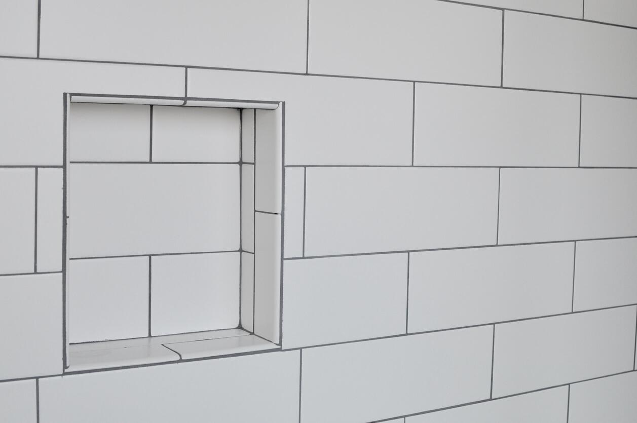 Oversized white subway tiles in bathroom shower.