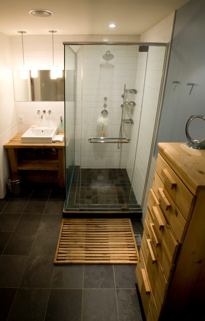 Bamboo Bath Mat on tiled floor infront of shower cubicle
